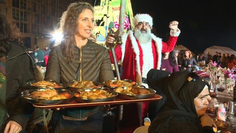 Lebanon activists serve up Christmas dinner in Beirut protest square   AFP