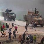 Civilians Throw Rocks at Turkish Military Convoy in Northwestern Syria