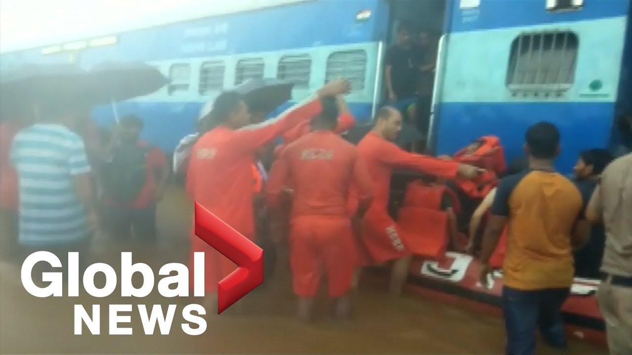 Hundreds rescued from train stuck in floods hitting Mumbai